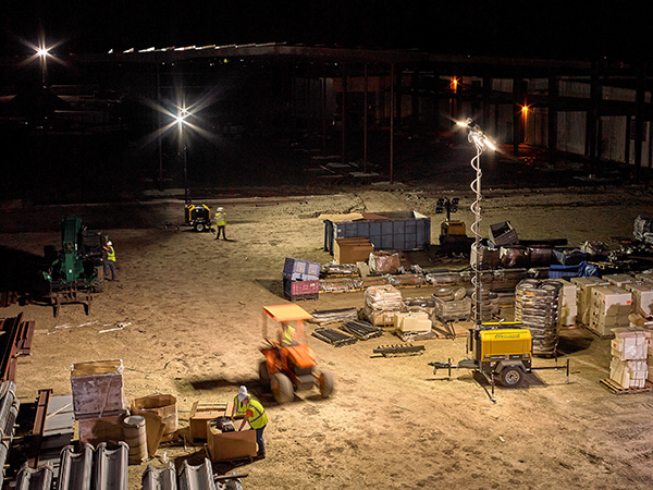 Allmand light towers light up work area